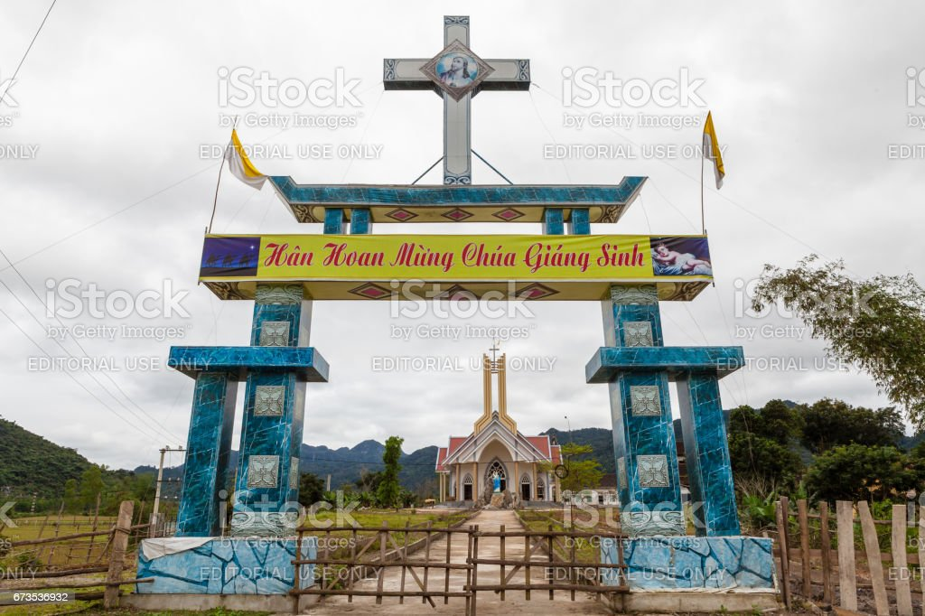 'Happy Christmas' writing in vietnamese on the gate to catholic church. stock photo