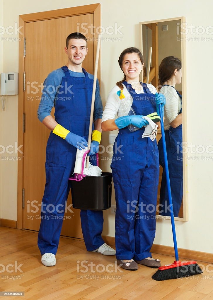 Happy cleaners team is ready stock photo