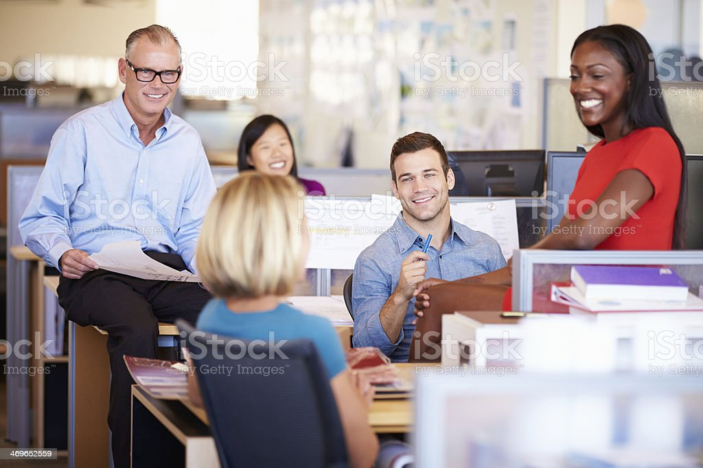 Happy colleagues have meeting in open plan office stock photo