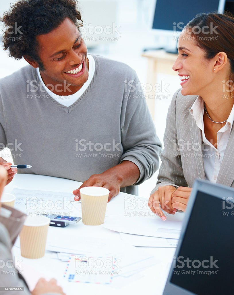 Happy colleagues having a business meeting royalty-free stock photo