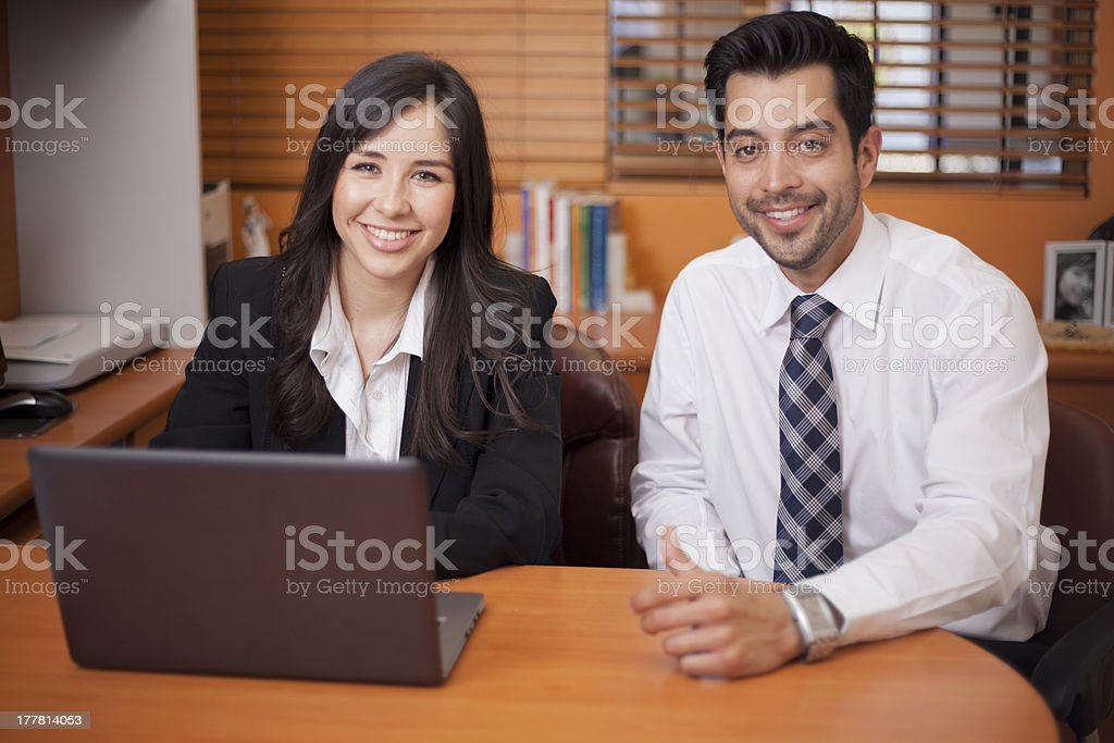Happy colleagues working together stock photo