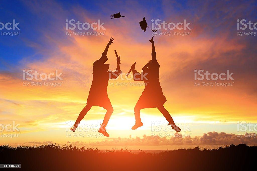 happy college graduate student jump stock photo