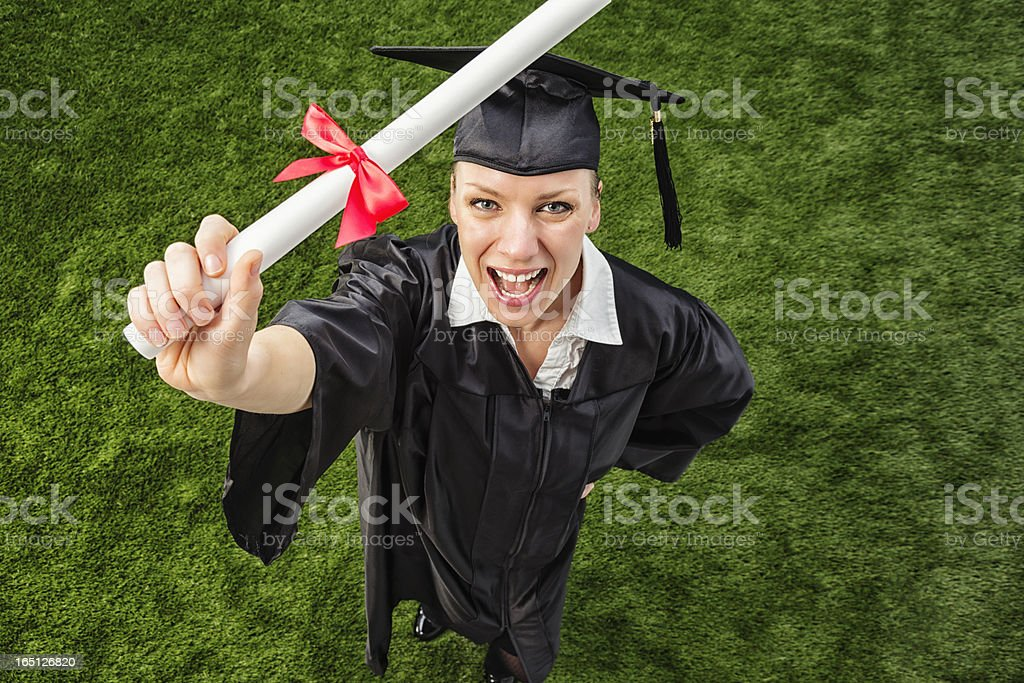 Happy College Graduate with Diploma royalty-free stock photo