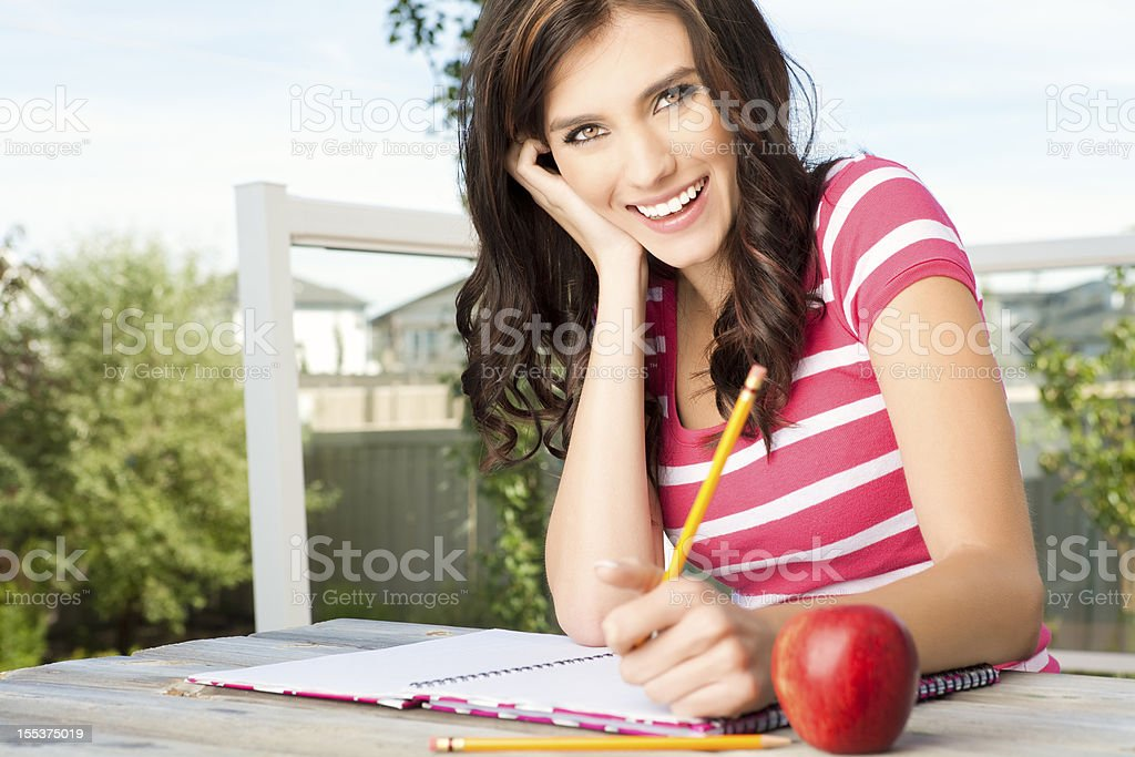 Happy college student doing homewrk royalty-free stock photo