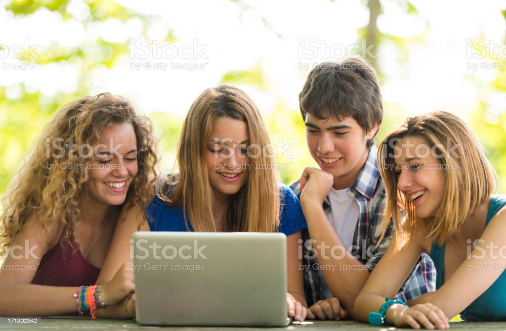 Happy college student friend studying with laptop and surfing royalty-free stock photo