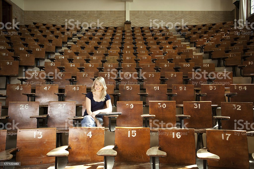 Happy College Student in Lecture Hall stock photo