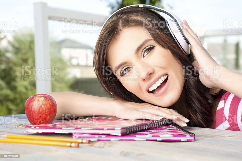 Happy college student listening to headphone royalty-free stock photo