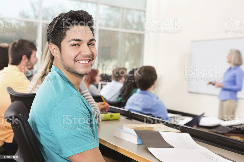 Happy college student smiling in lecture hall classroom royalty-free stock photo