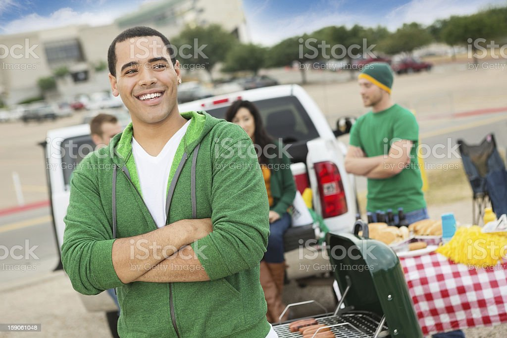 Happy college student tailgating with friends near football stadium royalty-free stock photo
