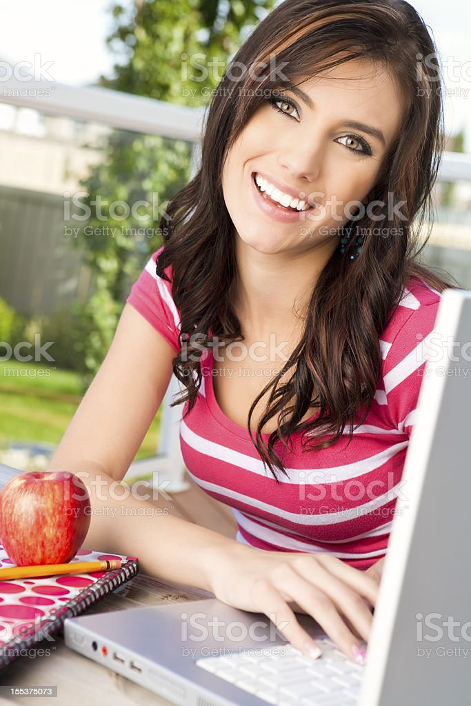 Happy college student using laptop royalty-free stock photo
