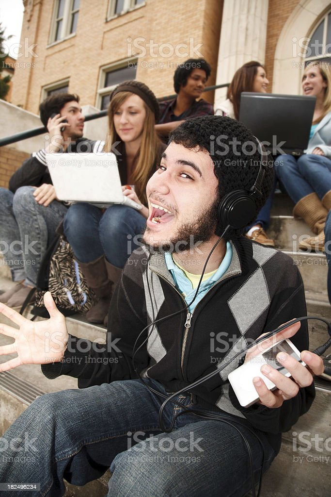 Happy College Student With Headphones and Hands Out royalty-free stock photo
