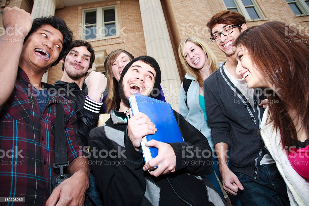 Happy College Students Cheering on a Friend royalty-free stock photo