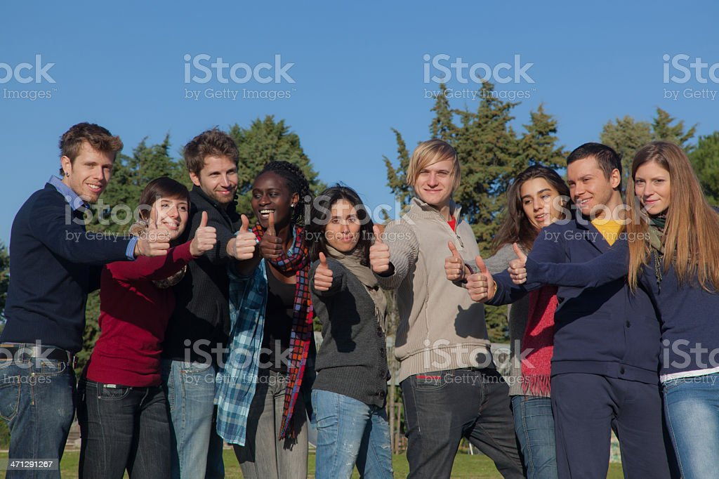 Happy College Students with Thumbs Up royalty-free stock photo