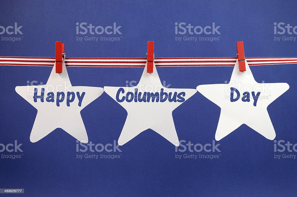 Happy Columbus Day message hanging from pegs on a line stock photo