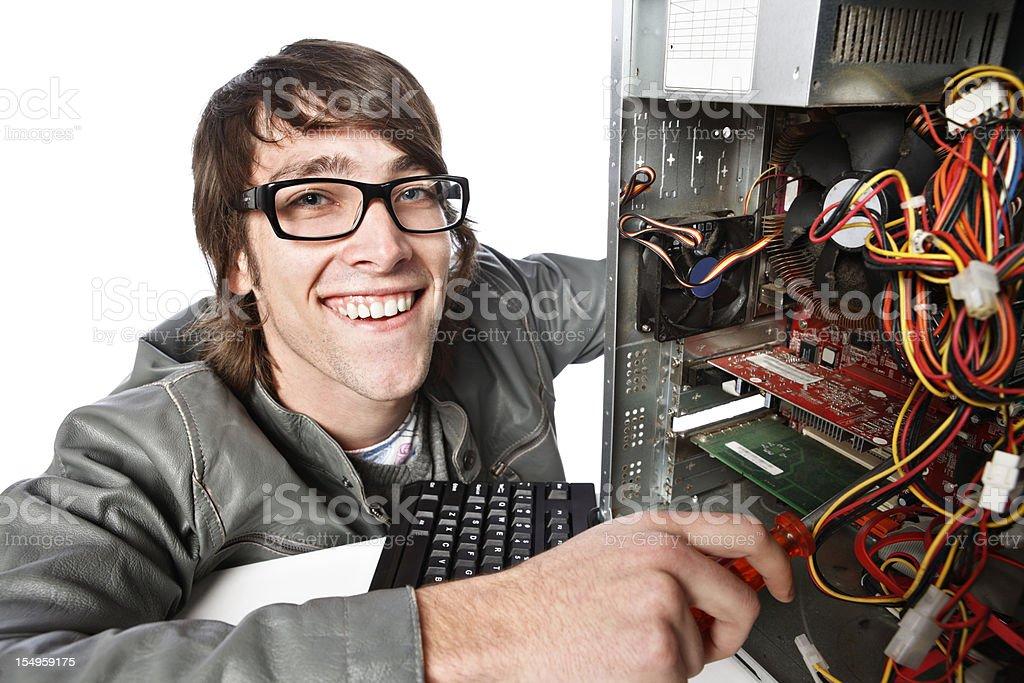 Happy computer repairman enjoys his work royalty-free stock photo