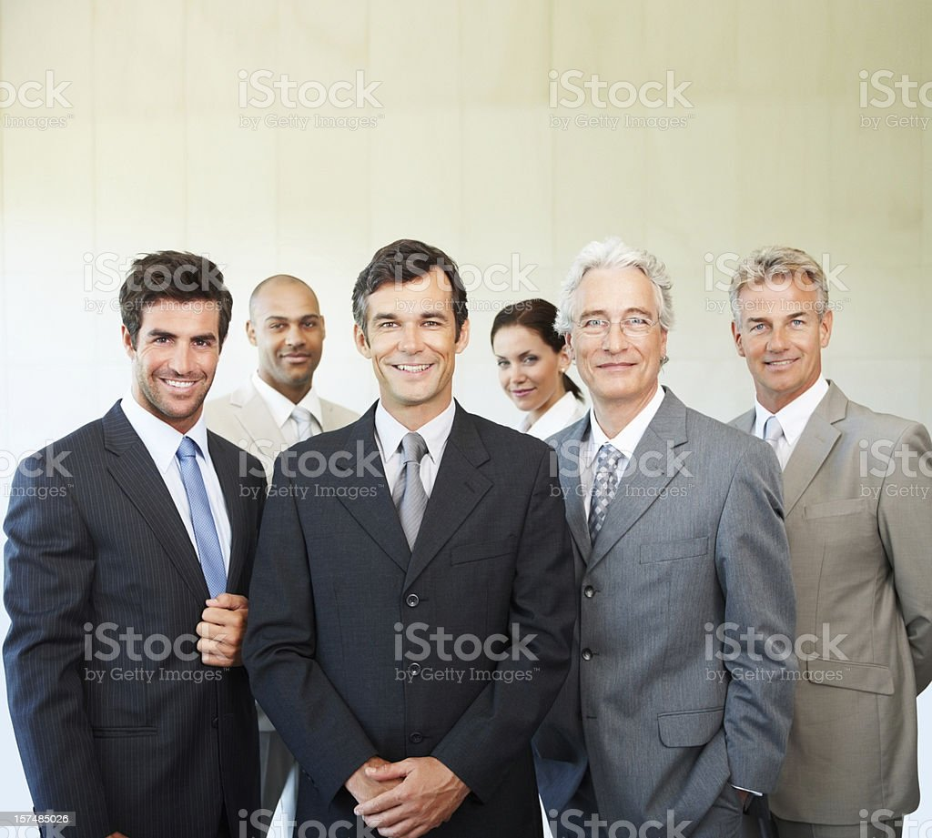 Happy confident business colleagues posing royalty-free stock photo