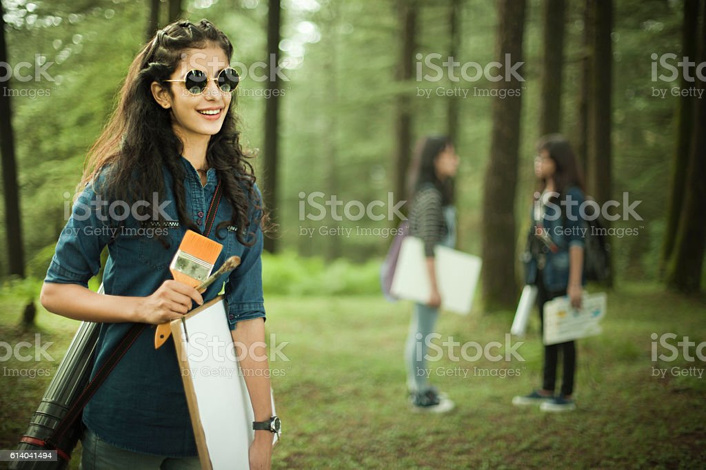 Happy, confident, female fine art college students in outdoor location. stock photo