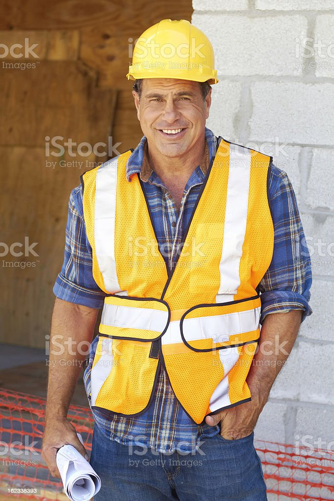 Happy Confident Mature Construction Worker With Blueprint royalty-free stock photo