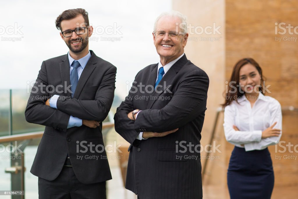 Happy confident people working in strong company stock photo