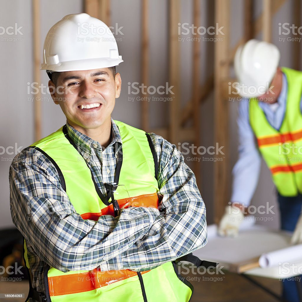 Happy construction worker in house building site royalty-free stock photo