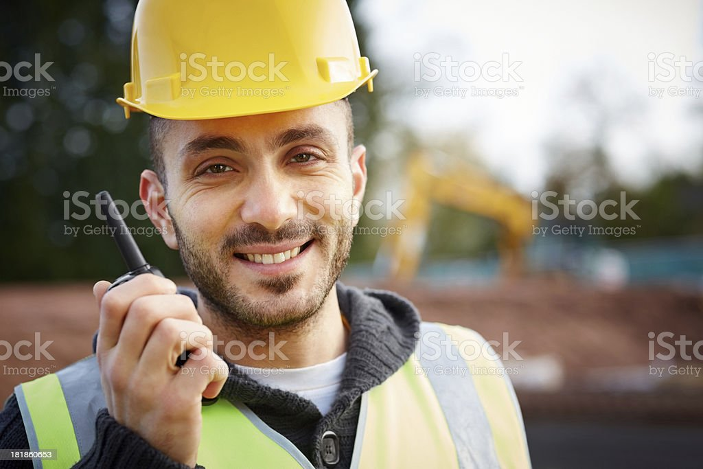 Happy construction worker on walkie talkie stock photo