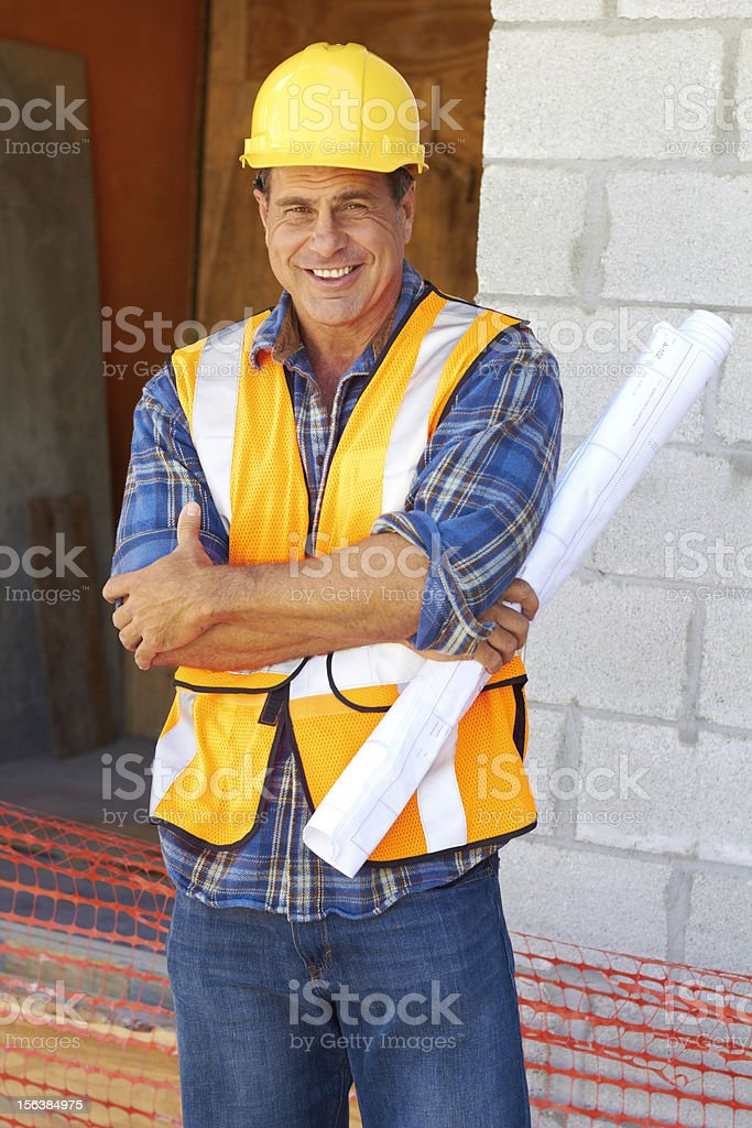 Happy Construction Worker With Blueprint royalty-free stock photo