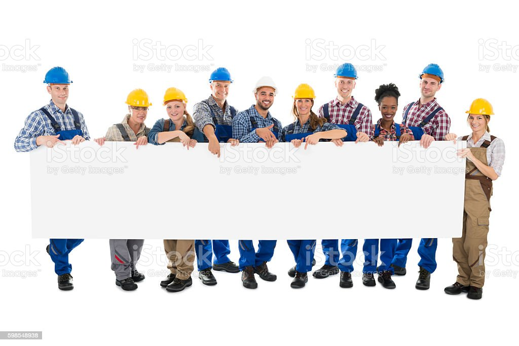 Happy Construction Workers Holding Blank Billboard stock photo