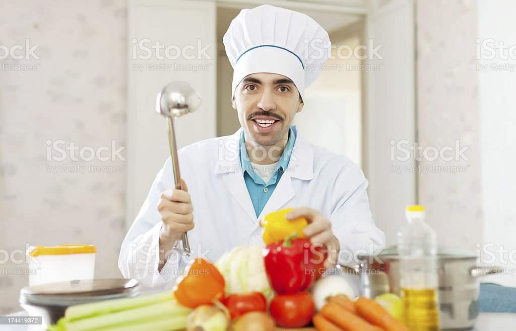 Happy cook  cooking with ladle royalty-free stock photo