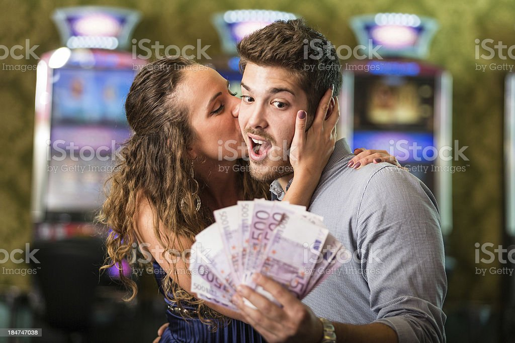 Happy Couple after Winning Money at Casino stock photo