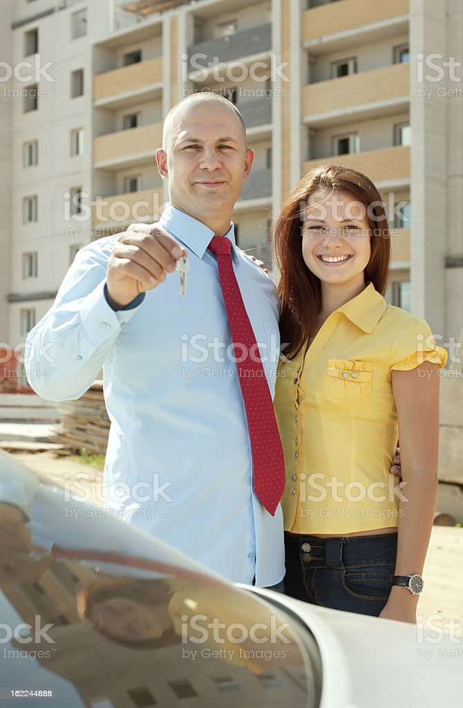 happy couple against real estate royalty-free stock photo
