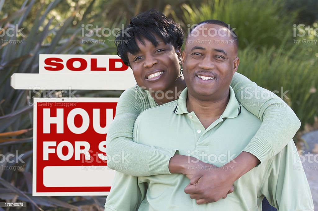 Happy Couple and Real Estate Sign royalty-free stock photo