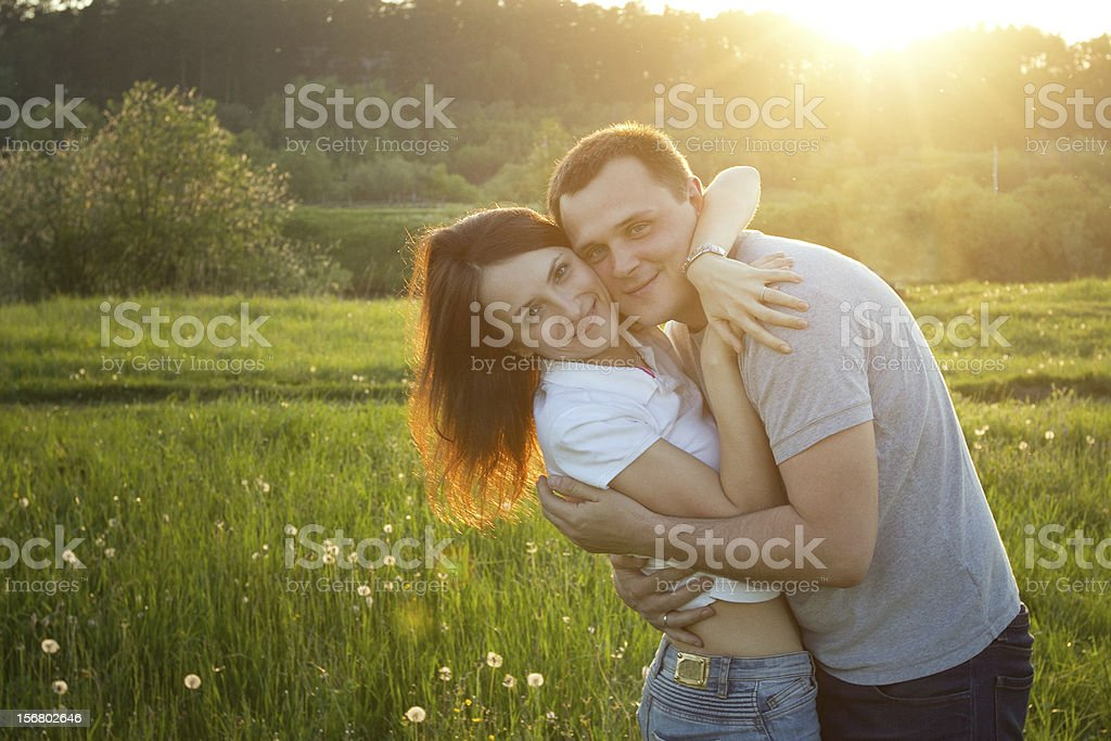 happy couple at sunset royalty-free stock photo