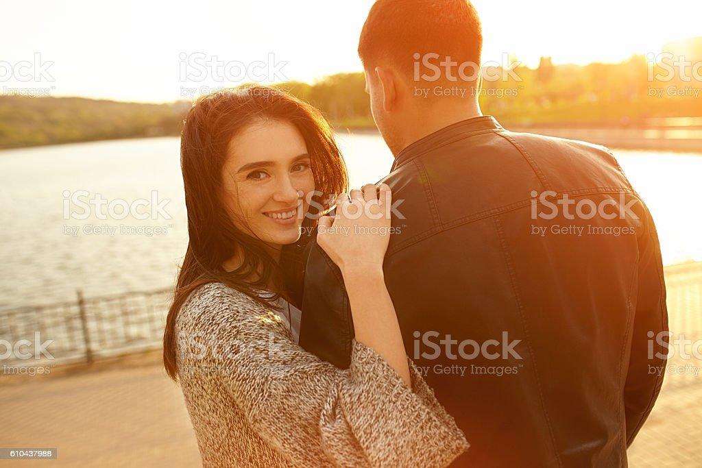 Happy couple at sunset stock photo