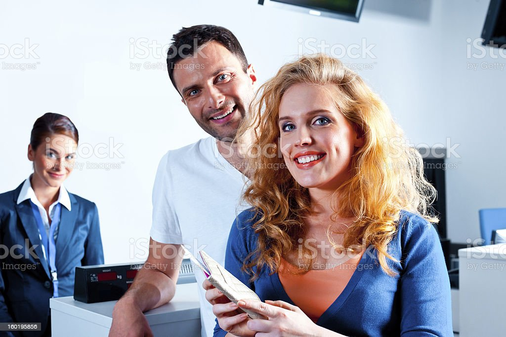 Happy couple at the airport royalty-free stock photo