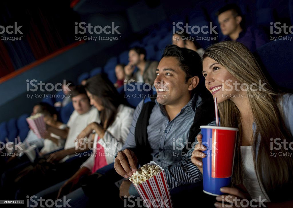 Happy couple at the movies stock photo