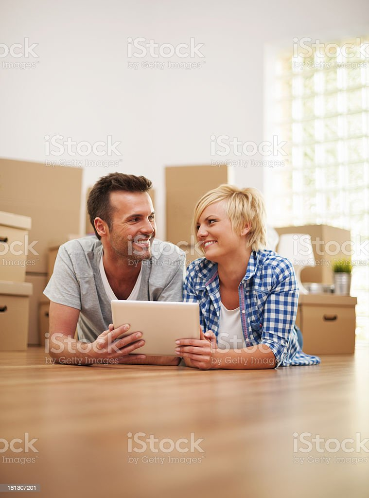 Happy couple at the new apartment with digital tablet royalty-free stock photo