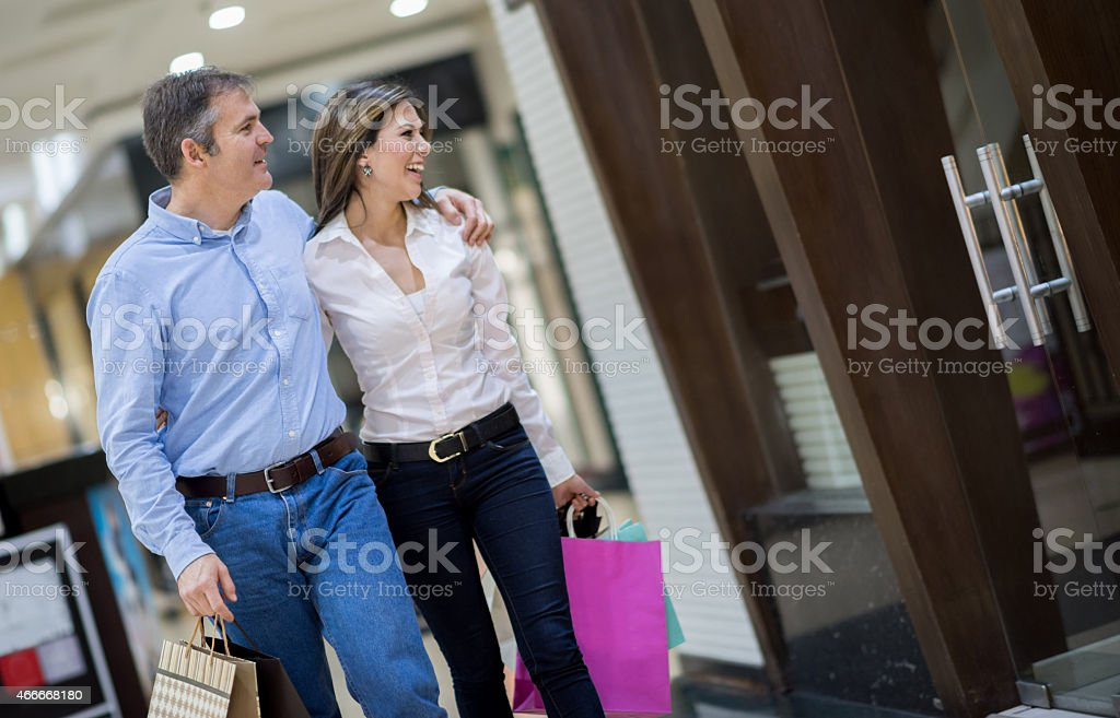 Happy couple at the shopping center stock photo