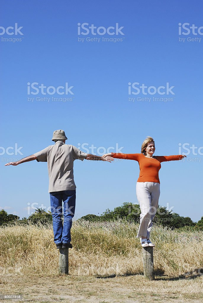 Happy couple balancing royalty-free stock photo
