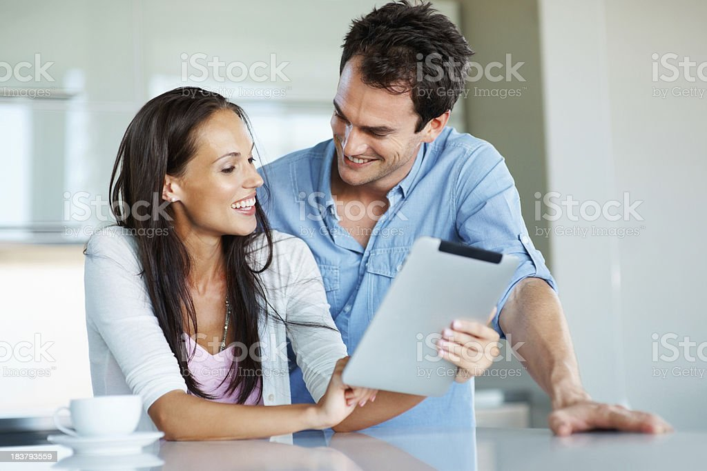Happy couple browsing the internet royalty-free stock photo