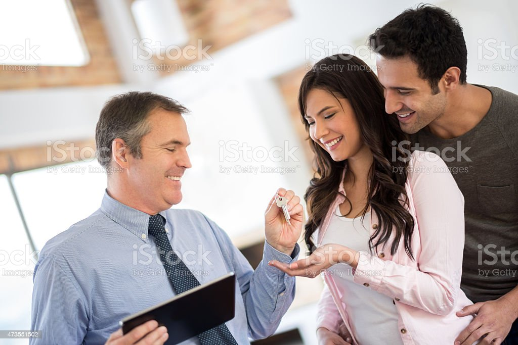 Happy couple buying a house stock photo