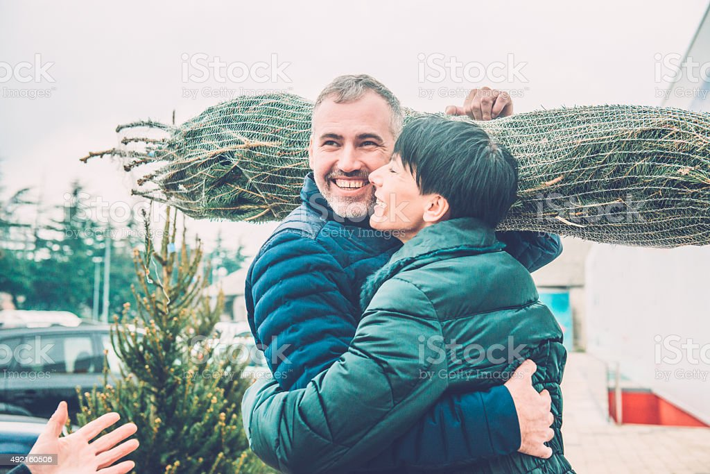 Happy Couple Buying Christmas Tree, Europe stock photo