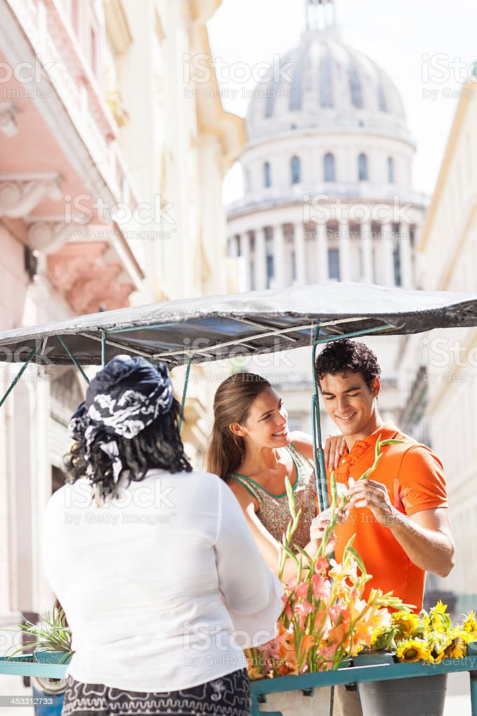 Happy couple buying flowers royalty-free stock photo