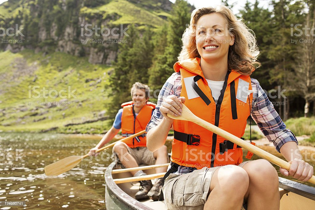 Happy Couple Canoeing stock photo