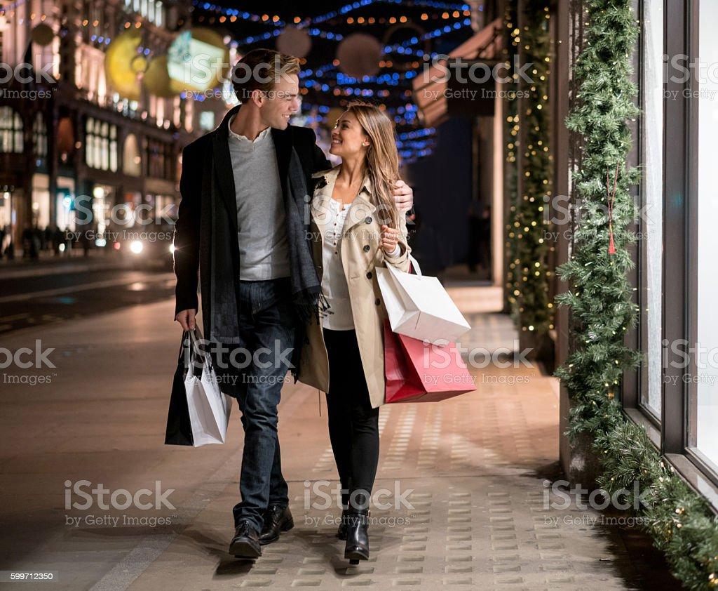 Happy couple Christmas shopping stock photo