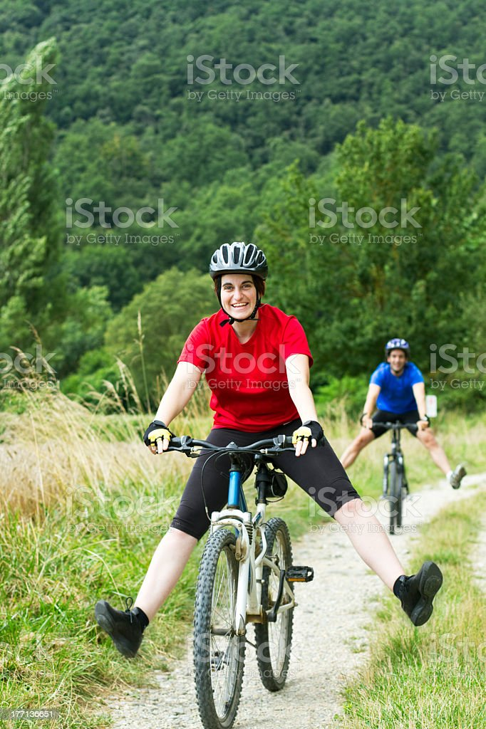 Happy couple cycling royalty-free stock photo