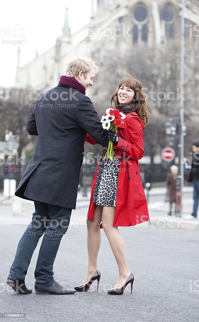Happy couple dancing near Notre Dame de Paris royalty-free stock photo