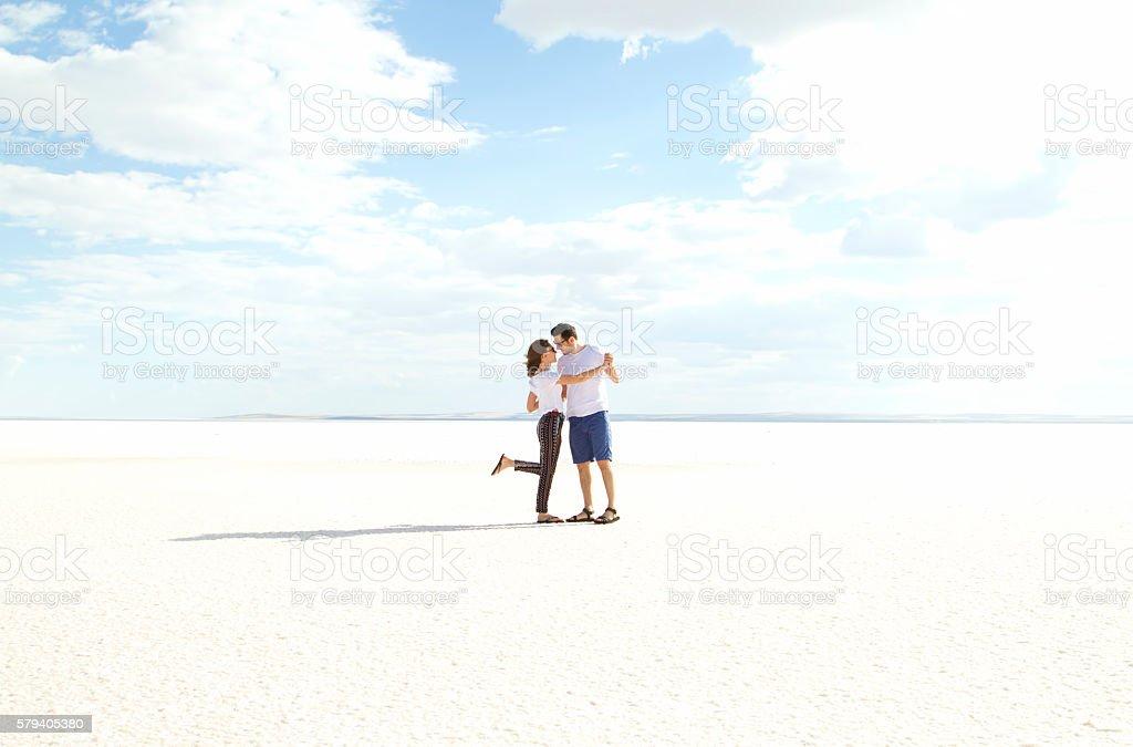 Happy couple dancing on salt lake stock photo