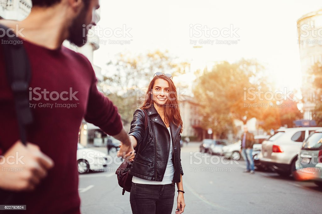 Happy couple dating outside stock photo