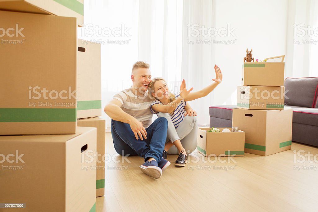 Happy couple dreaming about their dream house stock photo