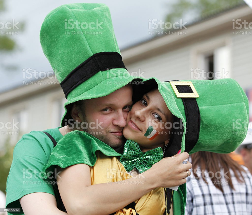 Happy couple dressed as leprechauns for Saint Patrick's Day stock photo